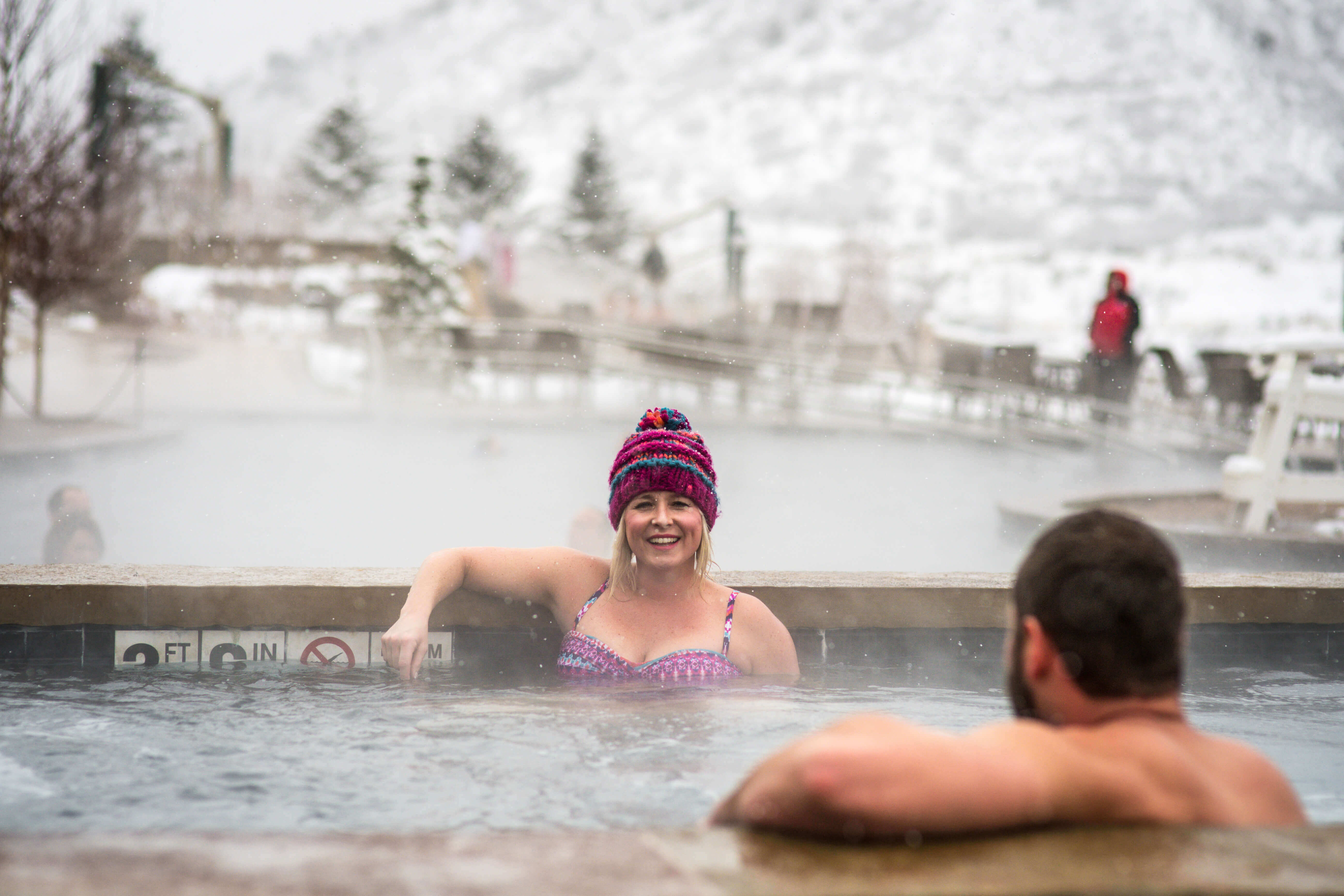 Couple in jetted pool at Iron Mountain Hot Springs in winter