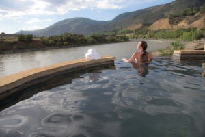 Woman in infinity pool at Iron Mountain Hot Springs