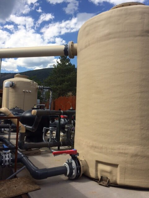 Pure chemical-free geothermal water is first stored in fiberglass holding tanks.